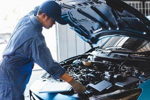Car mechanic checking to maintenance vehicle by customer claim photo