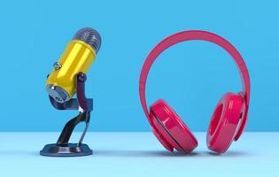 Micrófono de podcast amarillo y auriculares de color rosa sobre fondo azul. foto