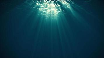 Rays of Sunlight Penetrate Clear Water.4K video