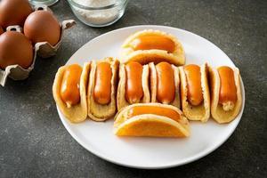 flat pancake roll with sausage photo