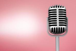 micrófono retro con espacio de copia sobre fondo rosa foto
