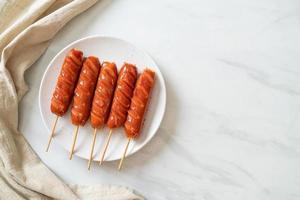 fried sausage skewer on plate photo