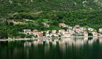 Village reflections in Kotor Bay photo