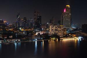 cityscape of bangkok and Chao Phraya River at night photo