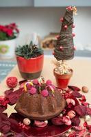 Christmas decoration with chocolate cake and christmas tree photo