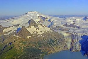 Aerial View of a Remote Volcano and Glacier in Alaska photo
