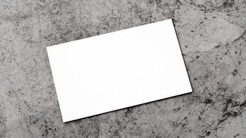 White business card on concrete for mockup photo