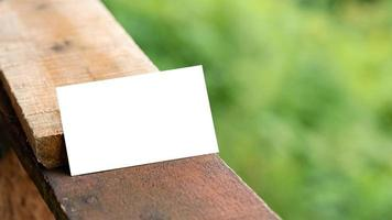 White business card on wooden palette for mockup photo