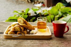 Banana French toast with honey and Hot coffee drinks on wood table photo