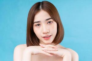 Attractive young Asian woman with youthful skin. photo