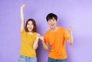Asian couple portrait, isolated on purple background photo