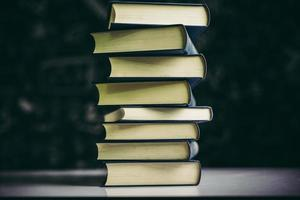 The books are placed in a stack of books on the table photo