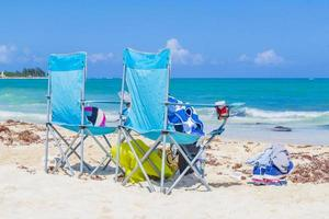 Blue lounge chairs on the beach Playa del Carmen Mexico. photo