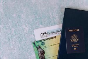 Individual Income Tax return form 1040 U.S. and American passport photo