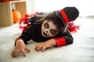 Portrait Asian little girl in Halloween costume acting scary Halloween photo