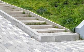 Steps from paving slabs and curbs. photo