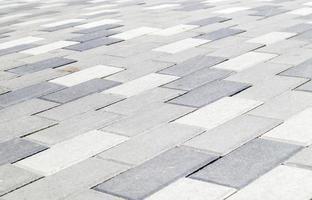 losas o piedras grises de pavimentación de hormigón o pavimentadas recién colocadas para suelos foto