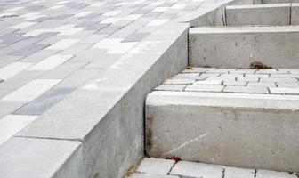 Steps from paving slabs and curbs. Rows of gray steps made of gray photo