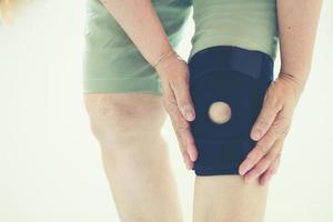 Soft focus of old Asian women with knee injury photo
