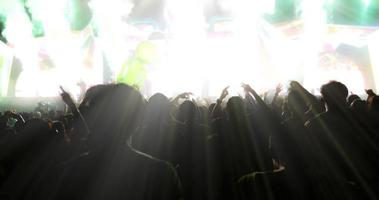 Blurry of silhouette of a concert crowd photo