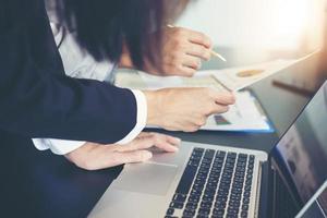Businesswomen analysing documents photo