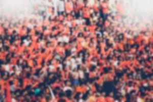 fondo borroso del aficionado al fútbol foto