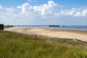Sandy beach and jetty at Spurn Point, East Yorkshire, England photo