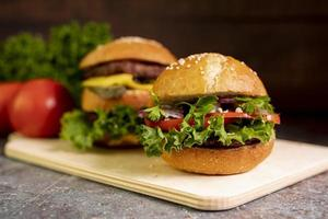 Close up of hamburgers on cutting board photo