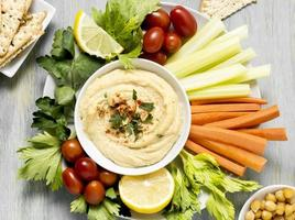 Hummus with assortment of vegetables photo