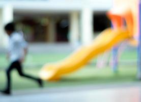 Blurred images of children playing in the school playground photo