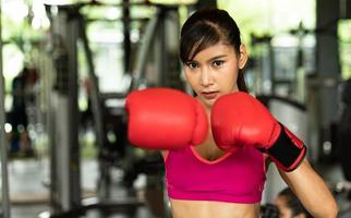 Young women exercise at the gym to strengthen the body photo