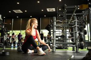 Young women work out at the gym to strengthen the body photo