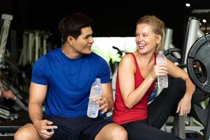 Young couples work out at the gym to strengthen the body photo