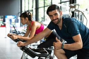 Young couples work out at the gym to strengthen the body. photo
