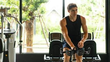 Young men work out at the gym to strengthen the body photo