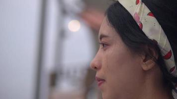 Close up smiling face young asian woman looking at camera. video
