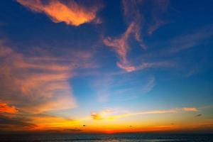 Amazing seascape with sunset clouds photo