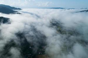 Aerial view drone shot of flowing fog waves photo