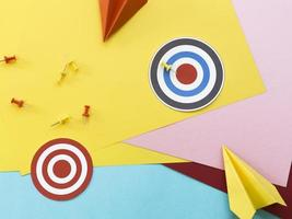 Paper targets with pins and paper planes photo