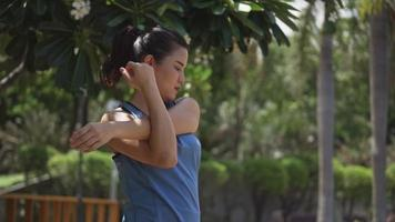 Beautiful young asian sports women stretching and preparing to run. Sportswoman running healthy lifestyle. video