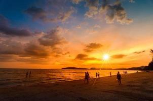 Ao Nang Krabi, Thailand, 2020 - People on the beach at sunset photo