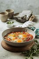Tasty egg meal pan from high angle photo