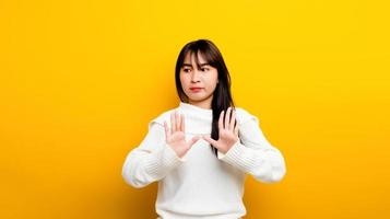 Easily upset Portrait of an Asian girl Upset with arms photo