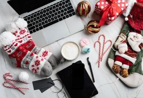 Christmas desktop with laptop, tablet and smart phone photo