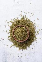 Mung beans top view on gray background photo