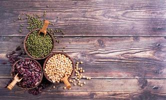 legumes in wooden bowls top view flat lay with copy space photo