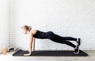 woman doing push ups at home photo