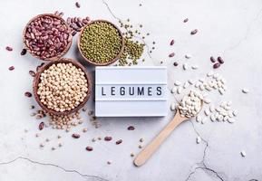 legumes with lightbox with the text Legumes top view flat lay photo