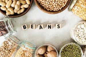 legumes Beans top view flat lay on white marble background photo