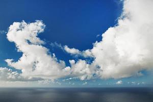 Huge cumulus cloud hovering over ocean photo